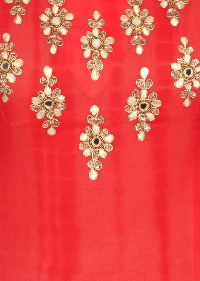 Coral kurti embellished in embroidered butti only on Kalki