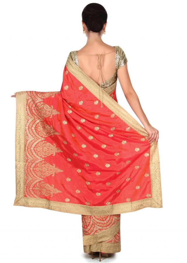 Coral saree adorn in zari in paisley motif embroidery only on Kalki