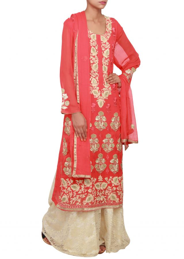 Coral straight fit suit featured in geogrette, embellished in zari and threda work only on Kalki