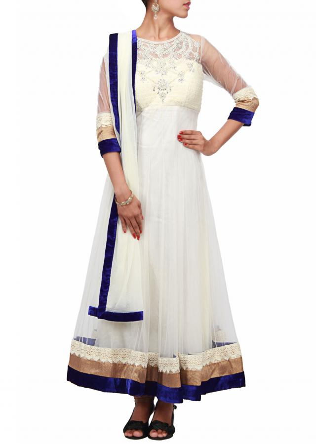 Cream anarkali suit with neckline adorn in stone and pearl only on Kalki