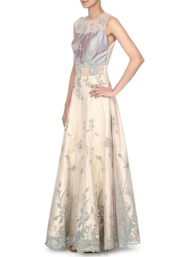 Cream and blue gown adorn in moti embroidery only on Kalki
