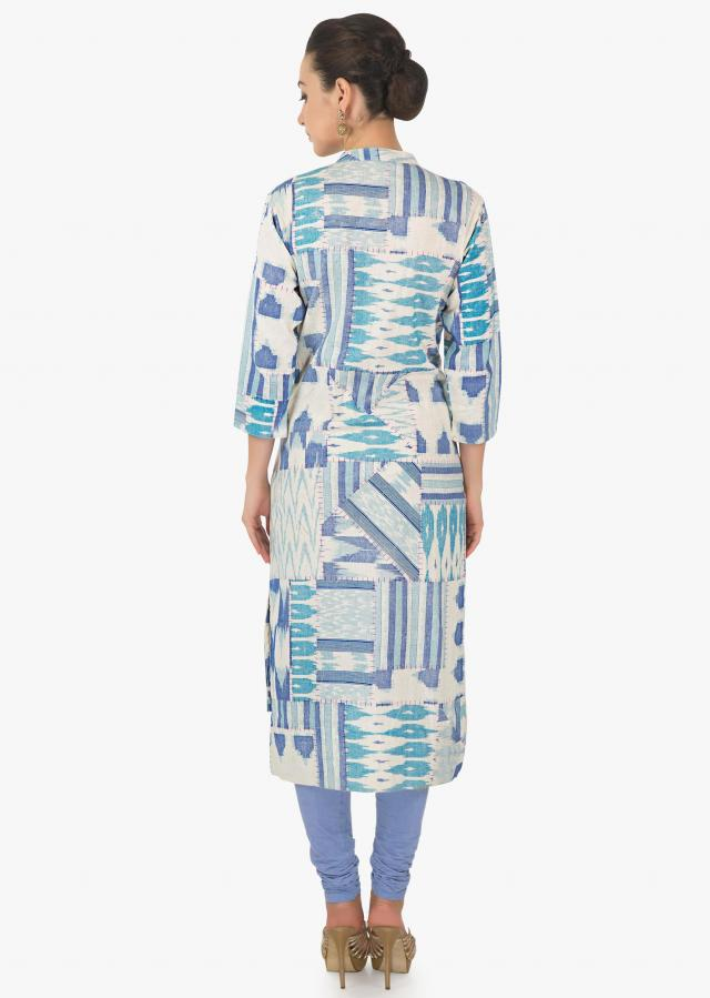 Cream and blue kurti featuring with fancy tassel on placket only on Kalki