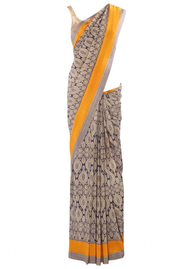 Cream and blue printed saree with mustard border only on Kalki