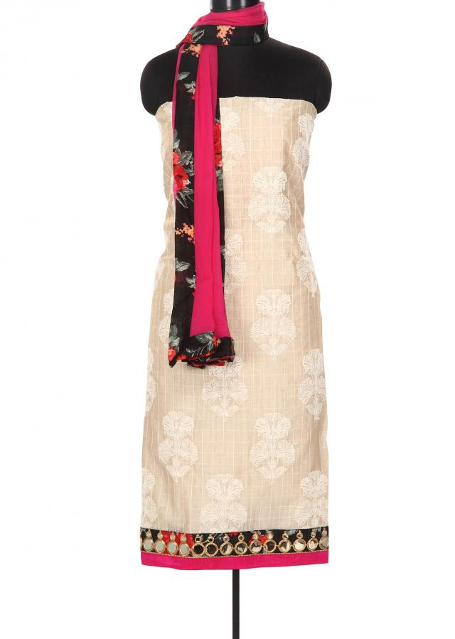 Cream and pink unstitched suit enhanced in thread butti