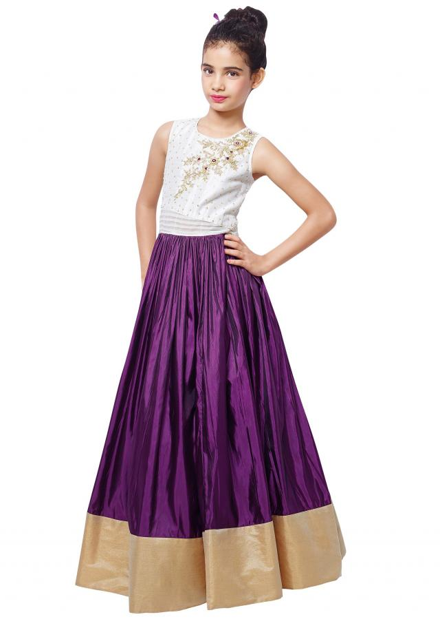 Cream and purple gown in zardosi embroidery