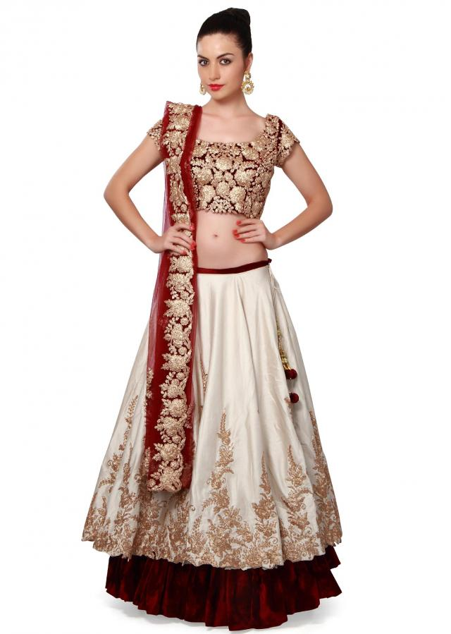 Cream and wine lehenga adorn in zari embroidery only on Kalki