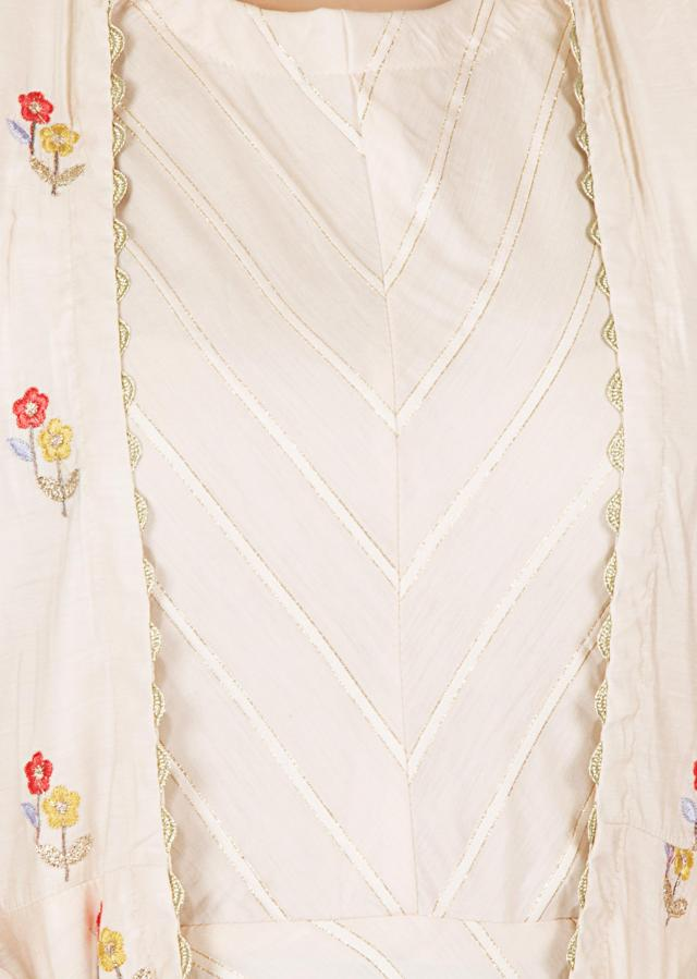 Cream cotton dress matched with a resham embroidery floral motifs jacket only on kalki