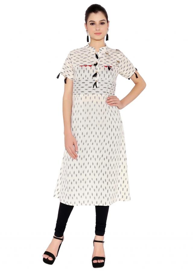 Cream Cotton Kurti With Bohemian Style Tassels On Button Placket And Sleeves Only On Kalki