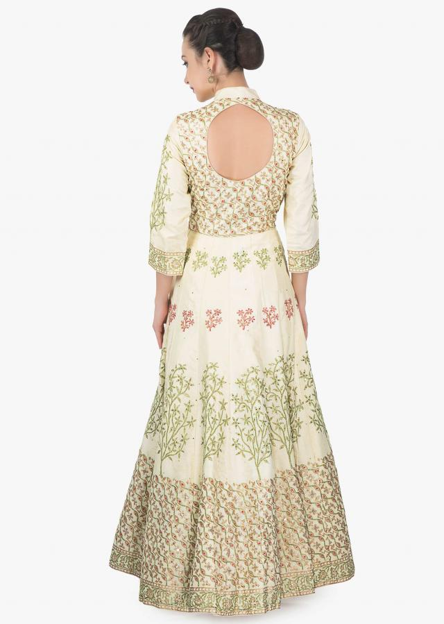 Cream cotton silk anarkali suit paired with pink net dupatta and lycra chudidar only on kalki