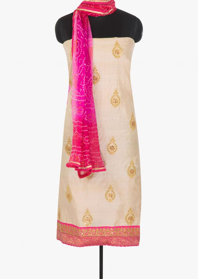 Cream cotton silk unstitched suit in gotta patch,sequin and a brocade hemline only on Kalki
