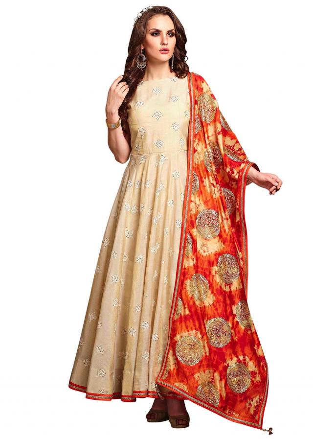 Cream embroidered anarkali suit with shaded dupatta only on Kalki