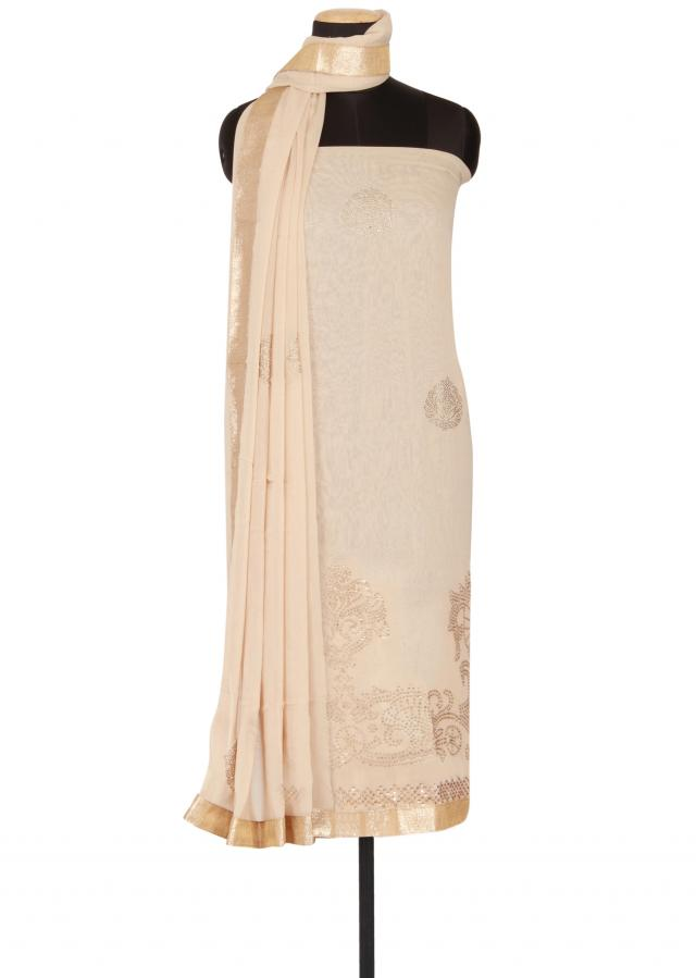 Cream georgette unstitched salwar-kameez embellished in kundan only on Kalki