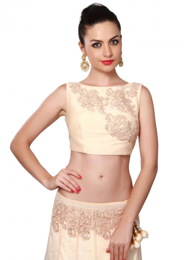 Cream lehenga adorn in resham and kardana embroidered butti. only on Kalki
