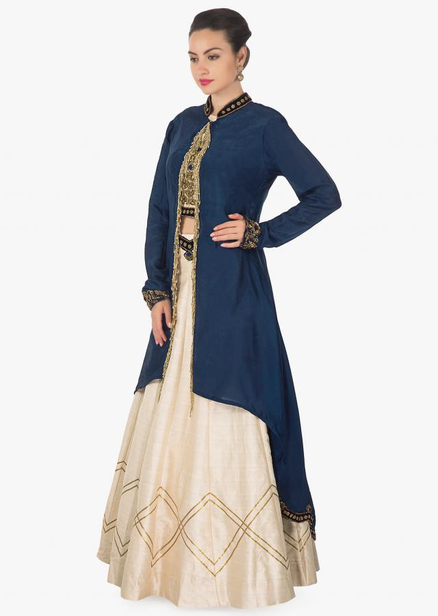 Cream lehenga and blouse in raw silk with navy blue jacket adorn in tassel only on Kalki