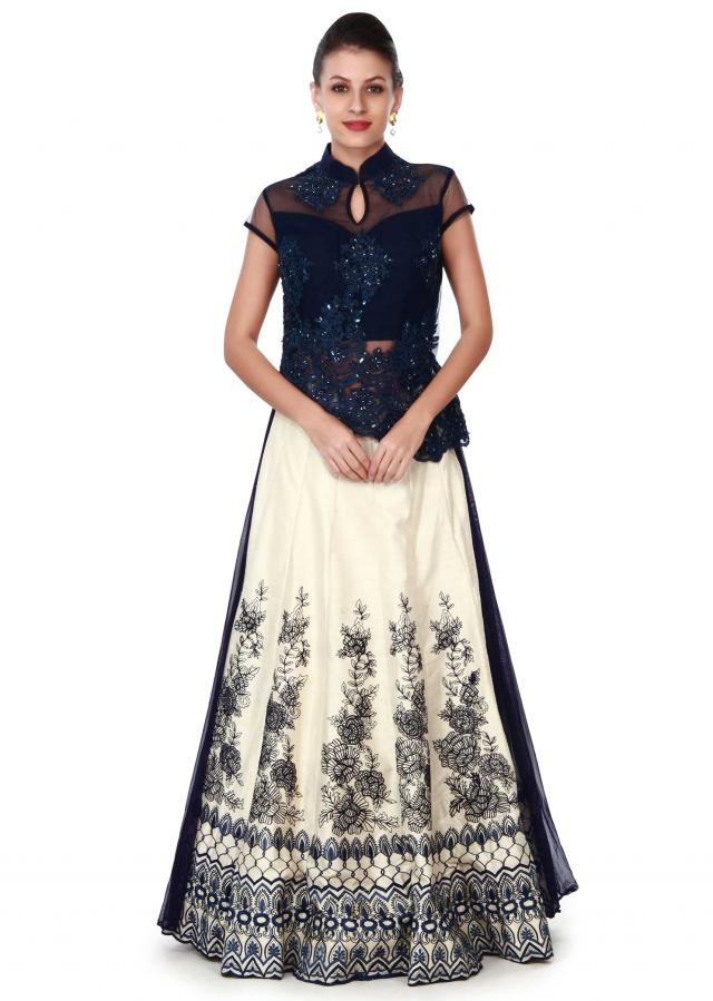 Cream lehenga with front short and back long blouse only on Kalki