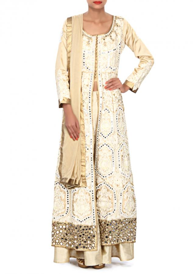 Cream outfit embellished in resham and mirror embroidery only on Kalki