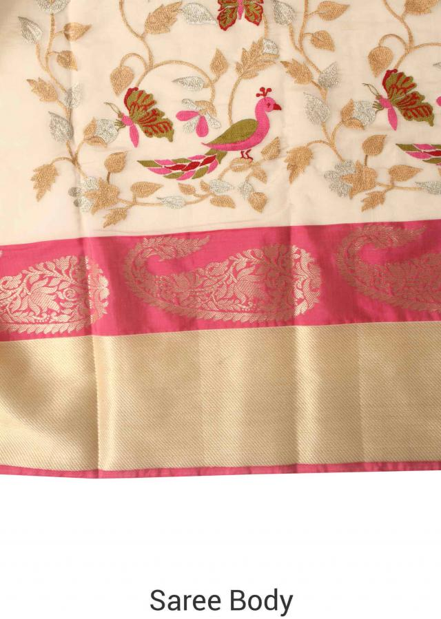 Cream saree adorn in bird and floral motif embroidery only on Kalki