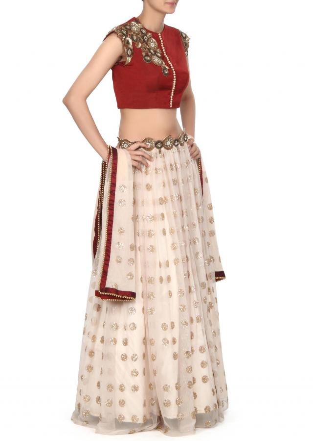 Cream shimmer lehenga adorn in sequin embroidery only on Kalki