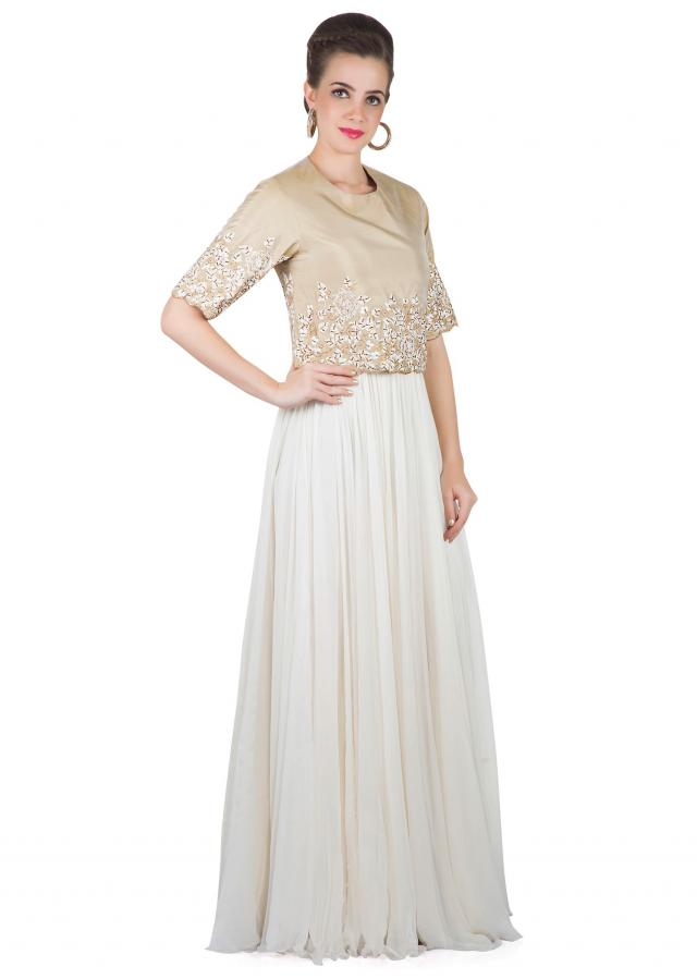 Cream Silk and Lurex Gown Adorned with Floral Embroidery only on Kalki