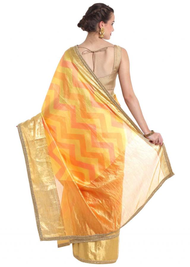 Cream silk saree crafted with gold lurex border only on Kalki