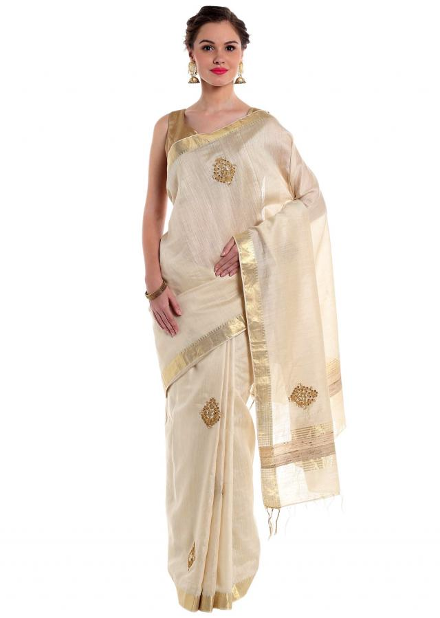 Cream silk saree flaunting zari and sequins  only on Kalki