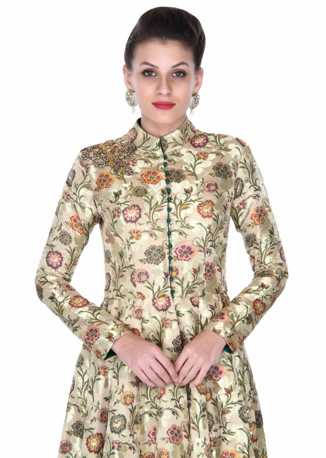 Cream suit adorn in fancy cut at hem line only on Kalki