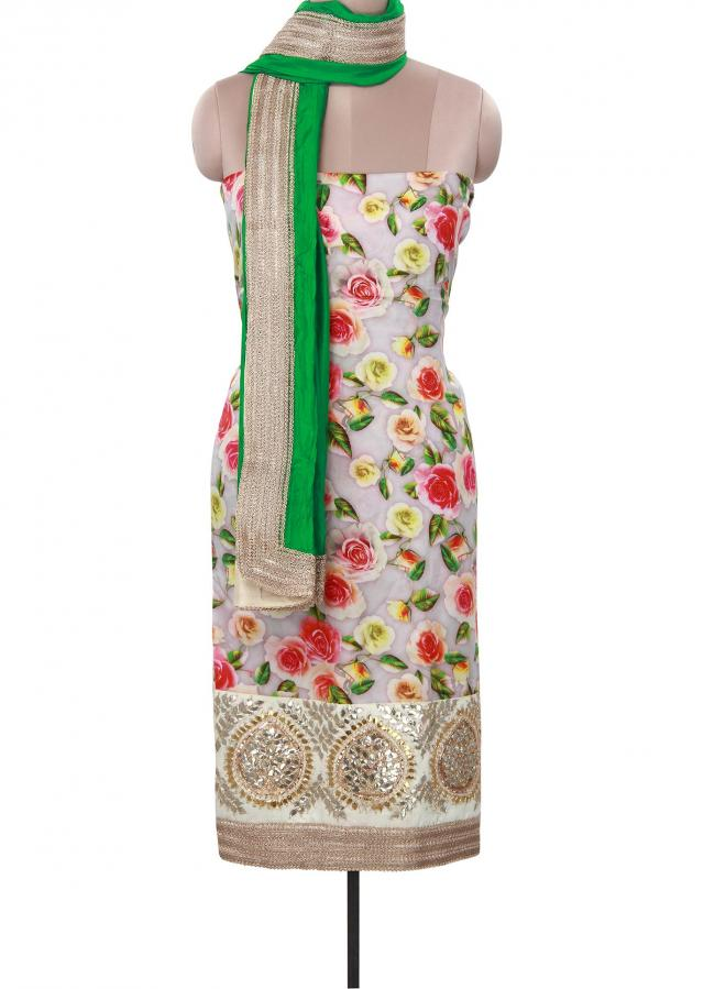 Cream unstitched suit enhanced in floral print. only on Kalki