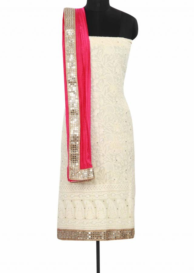 Cream unstitched suit enhanced in lucknowi thread work only on Kalki