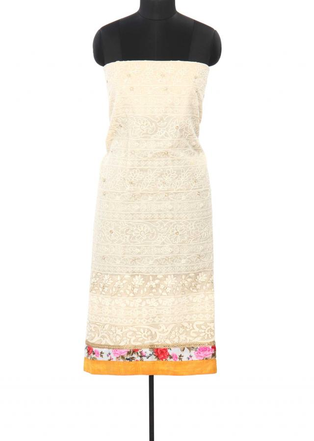 Cream unstitched suit enhanced in thread embroidery only on Kalki
