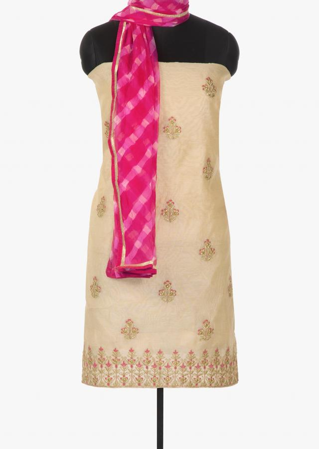Cream unstitched suit in cotton silk with floral motif embroidery only on Kalki