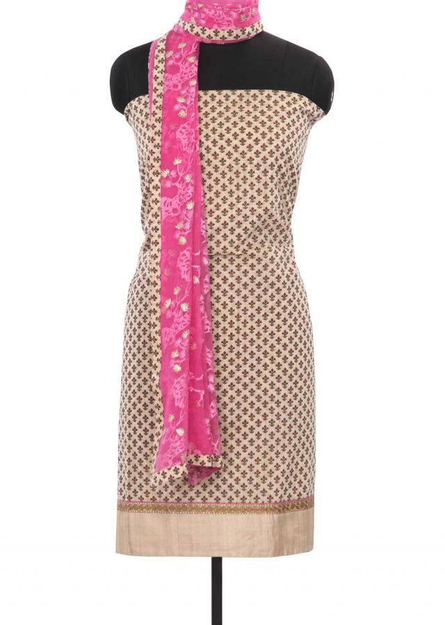 Cream unstitched suit matched with embroidered dupatta only on Kalki