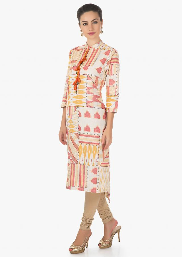 Cream, rust and orange blue kurti featuring with fancy tassel on placket only on Kalki