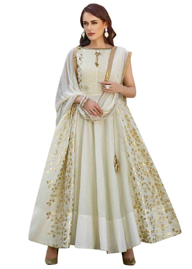 Cream anarkali suit highlighted in pleats and foil print