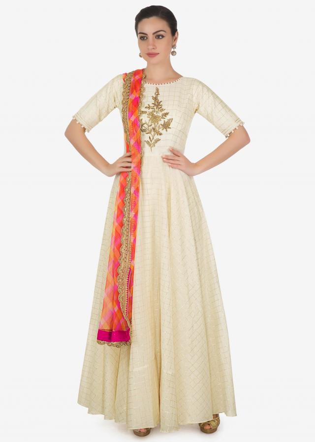 Cream anarkali suit in silk with embroidered bodice and multi color dupatta only on Kalki