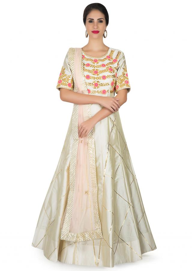 Cream anarkali suit in silk with french knot and gotta patch embroidery only on Kalki