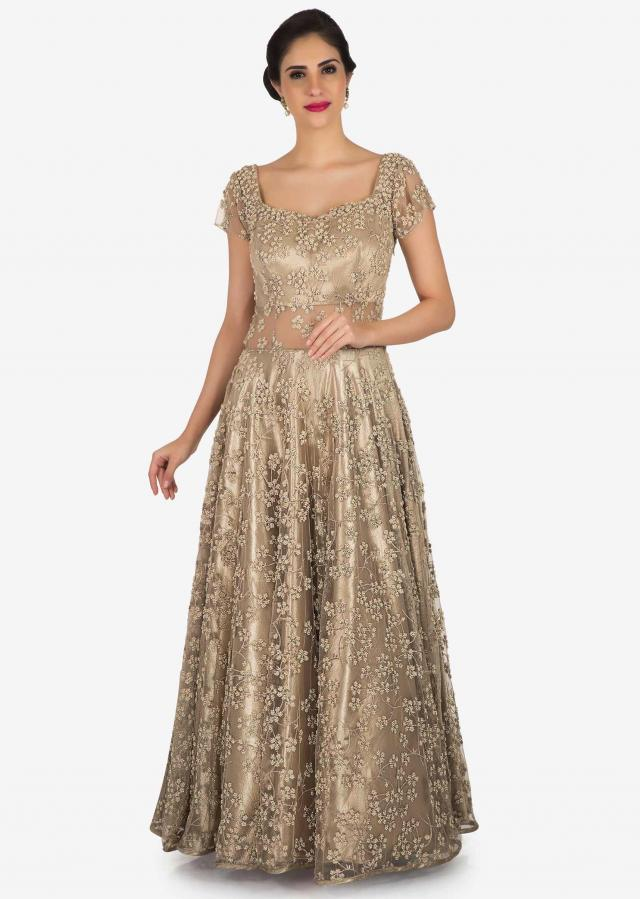 Cream and gold net gown embellished in zari and moti embroidery work only on Kalki