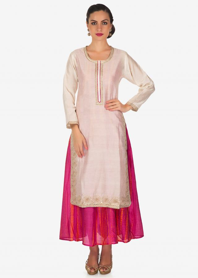 Cream and pink double layer kurti with batik print and zari neckline only on Kalki