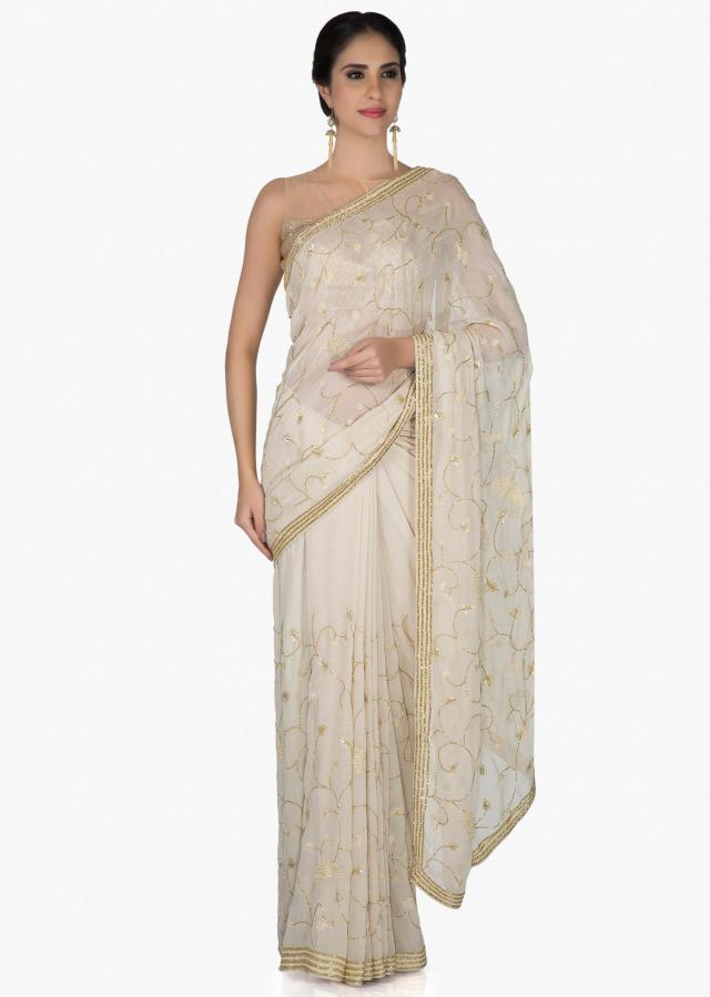 Cream Georgette Saree and Blouse Fashioned with Cut Dana and Sequins only on Kalki