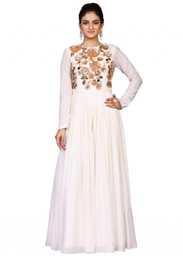 Cream gown in chanderi with Multi color tikki yoke enhanced in sequin embroidery only on Kalki