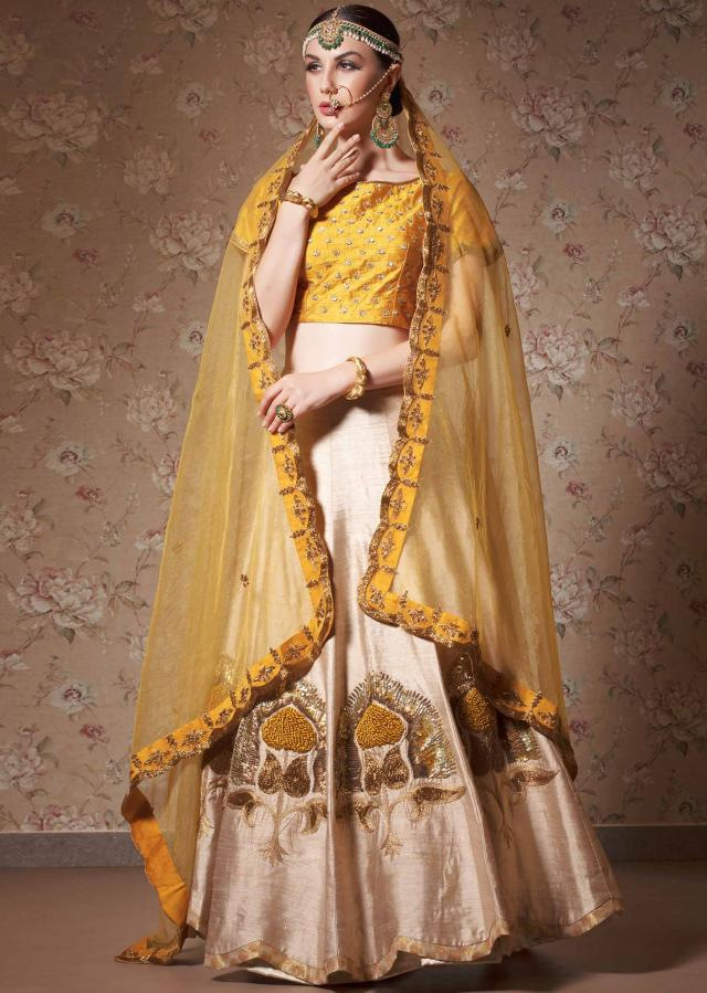 Cream lehenga and yellow blouse in sequin and french knot embroidery