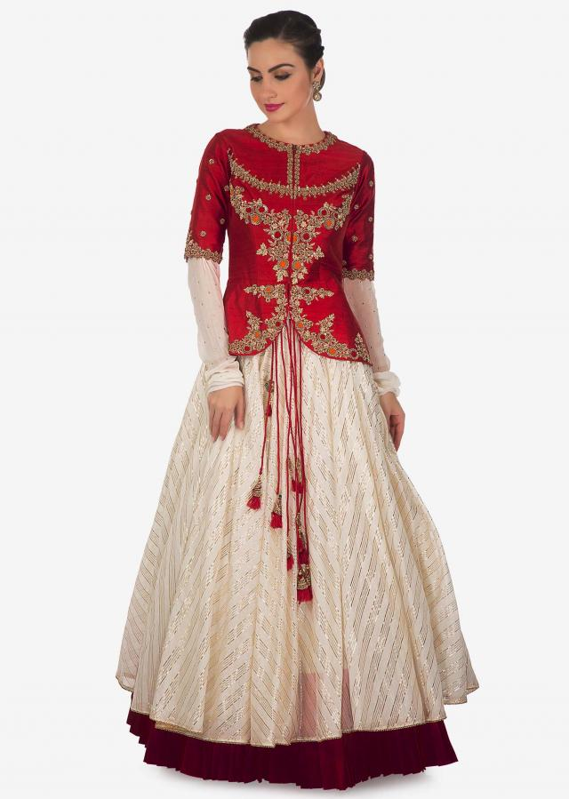 Cream lehenga matched with red raw silk embroidered jacket blouse only on Kalki