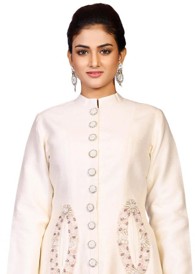 Cream pocket jacket with pant in raw silk featuring the moti stone embroidery only on Kalki