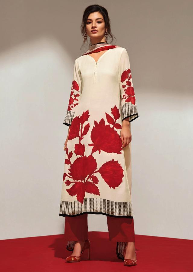 Cream unstithced suit with maroon floral print all overonly on Kalki