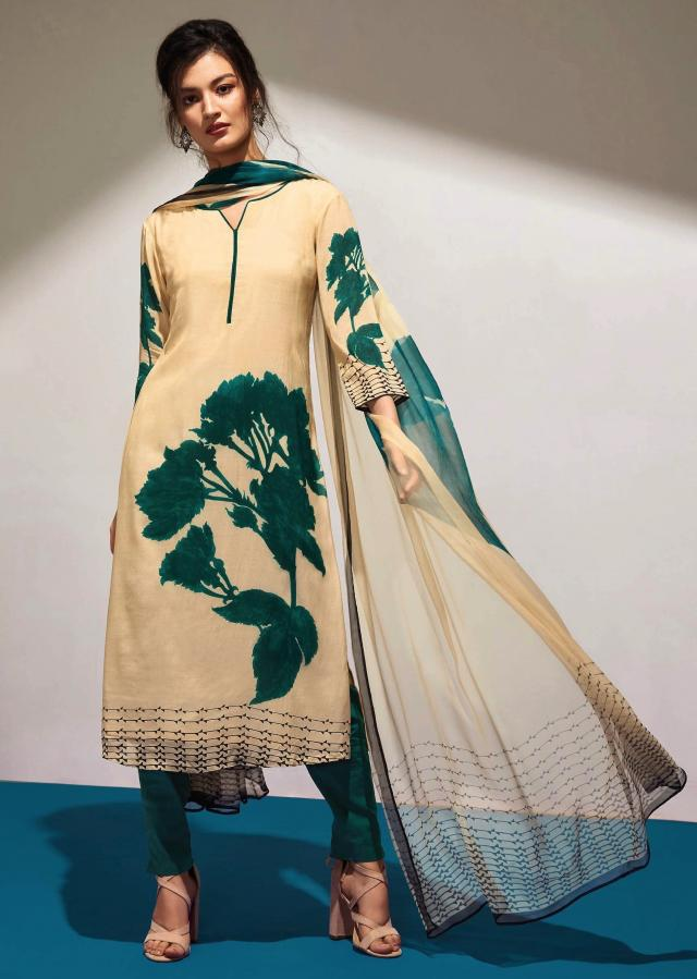 Cream unstithced suit with teal blue floral print all overonly on Kalki