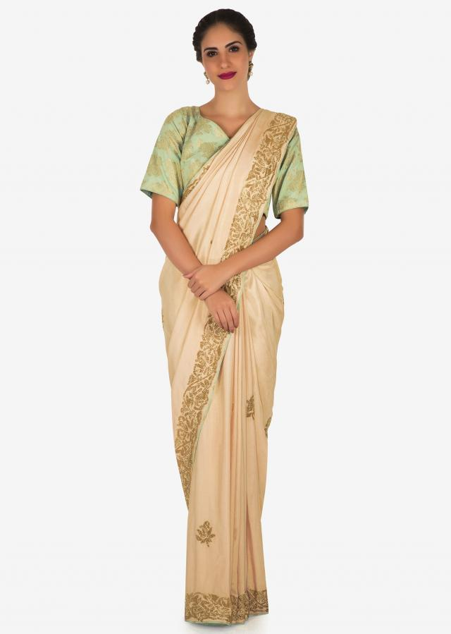 Creamish Pink Saree In Satin Silk With A Brocade Blouse Adorned In Cut Dana Work Online - Kalki Fashion