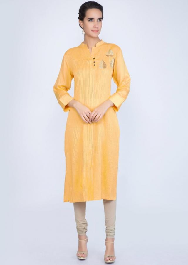 Dandelion yellow cotton kurti with pin tucks and leaf butti only on Kalki