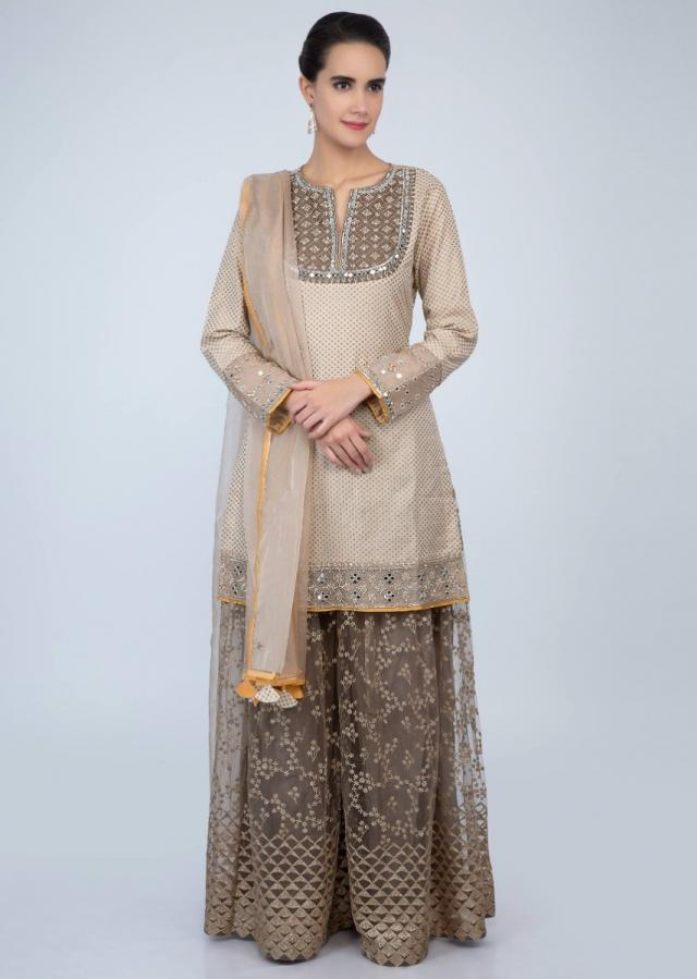 Dark cream weaved suit and organza dupatta with peanut brown embroidered net palazzo only on Kalki