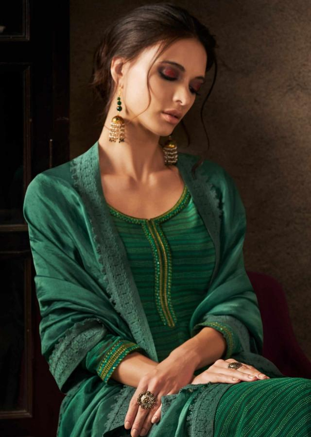Dark green unstitched suit in resham embroidered placket and hem line
