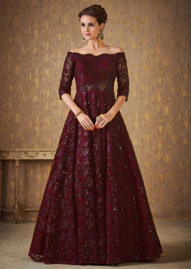 Dark maroon off shoulder gown adorn in embossed thread and sequin embroidery