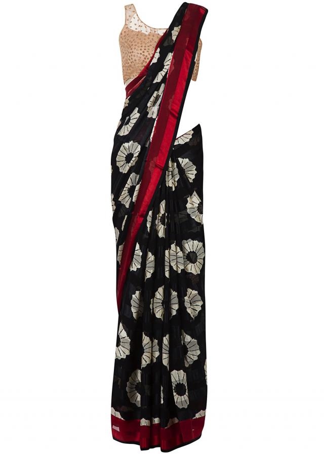 Dark blue saree in georgette with floral print only on Kalki